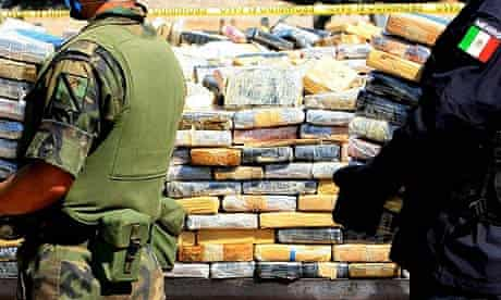 Members of the Mexican federal police and organise cocaine packages to be destroyed in Manzanillo port, Mexico