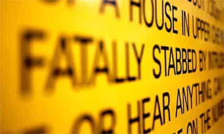 A police sign calling for information after a fatal knife crime
