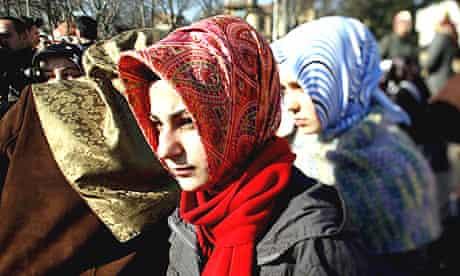 Turkish women wear headscraves at a demonstration in Ankara