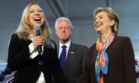Hillary Clinton campaigns in Sioux Falls, South Dakota, with daughter Chelsea and husband Bill. Photograph: Elise Amendola/AP