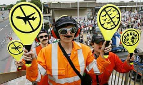 Protesters take part in a demonstration against the expansion of London's Heathrow airport