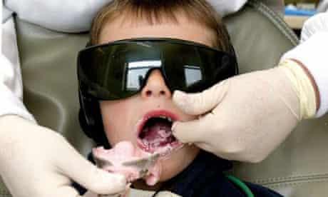 A child receives dental treatment