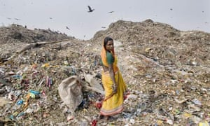 Woman in front of a rubbish dump