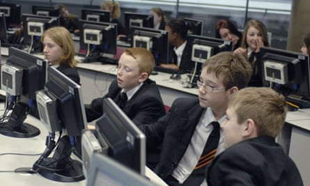 Pupils work at computers at the Thomas Deacon City Academy in Cambridgeshire