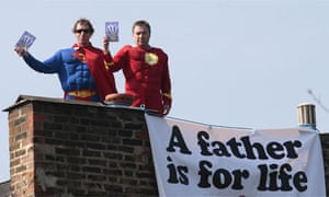 Two Fathers 4 Justice campaigners protest on the roof of the deputy Labour leader, Harriet Harman