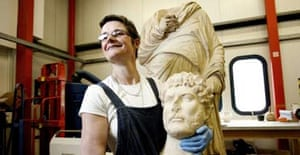 Conservator Tracey Sweekwith the head of Hadrian which the British Museum says was wrongly matched to its torso by well-meaning restorers in the 19th century