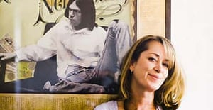 Alison Donald, managing director of chrysalis records, in front of a poster of Neil Young