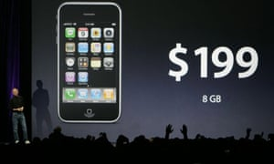 Attendees applaud as Apple CEO Steve Jobs announces that the new entry level Apple iPhone 3G will cost $199