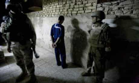 Iraqi soldiers in Shulla, north-west Baghdad, detain a man as they search a house in a Shia neighbourhood, a stronghold of Moqtada al-Sadr's Mahdi Army