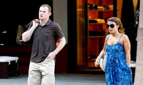 Wayne Rooney and Coleen McLoughlin walk in the main square of Portofino, Italy