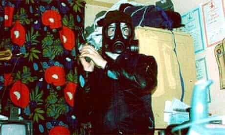 Barry George, the man accused of killing Jill Dando, is seen holding a gun and wearing a gas mask in an undated photograph shown to the jury
