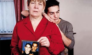 Maureen Shearer (with her surviving son Jason) holding a picture of her son Richard who was killed in Iraq