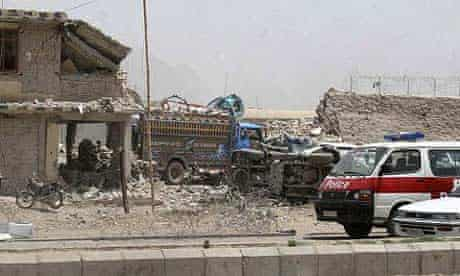 The destroyed entrance gate of the Kandahar prison that was attacked by Taliban militants