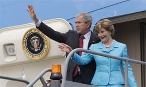 George Bush and Laura Bush wave from Air Force One after landing at Heathrow