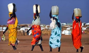 Women carrying water at a camp in northern, Sudan