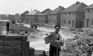 A bricklayer works on the site of a new housing estate built as part of the post-war programme in the 1950s