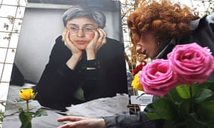 A woman lays flowers in tribute to the murdered Russian journalist Anna Politkovskaya