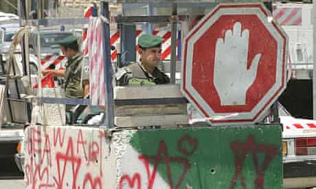 Israeli border guards man the Anata checkpoint between Jerusalem and the West Bank