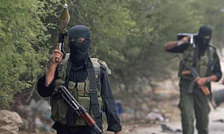 Palestinian gunmen from the militant wing of Hamas, leave their position at the beginning of a ceasefire near the border with Israel, east of Gaza City.