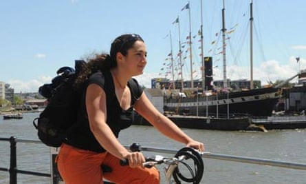 A cyclist rides past the SS Great Britain at Bristol Dock