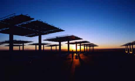The sun sets over solar panels in New Mexico. Photograph: Corbis