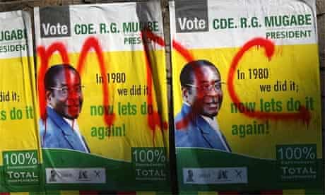 Posters for Robert Mugabe are covered with graffiti for the opposition Movement for Democratic Change in Harare, Zimbabwe. Photograph: Getty Images