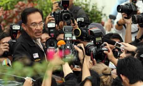 Malaysian opposition leader Anwar Ibrahim talks to the media after leaving the Turkish ambassador's home