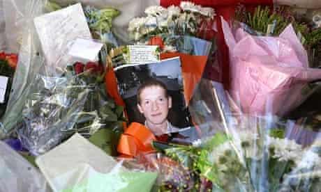A photo of Ben Kinsella lies among wreaths
