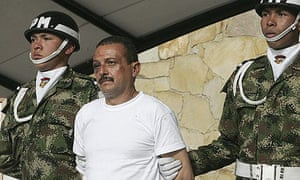 Farc member Gerardo Aguilar Ramirez, also knows as Cesar, is escorted by soldiers in Bogota after being captured by the Colombian army.