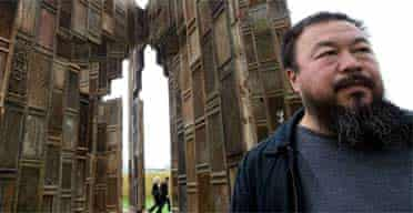 """Chinese artist Ai Weiwei poses in front of his installation """"Template"""""""
