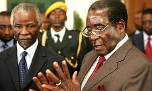 Robert Mugabe speaks to journalists after meeting the South African president Thabo Mbeki in Harare