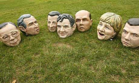 Costume heads representing seven of the eight G8 leaders lie on ground at Odori Koen Park in Hokkaido, Japan
