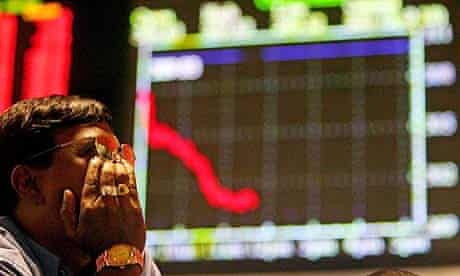 An investor in front of a graph showing stock market performance