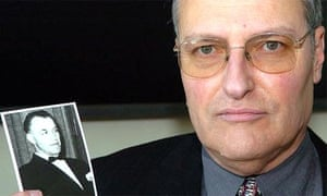 Efraim Zuroff, the head of the Simon Wiesenthal Centre, holds a photograph of his number one target, the Nazi war criminal Aribert Heim