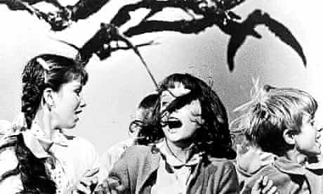 A girl is attacked by bloodthirsty birds in the 1963 Alfred Hitchcock film, The Birds