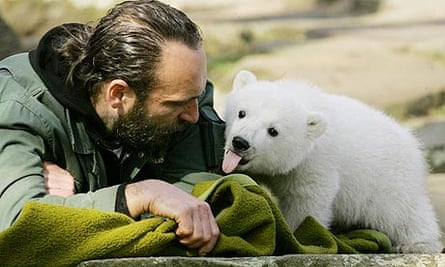 Zookeeper Thomas Doerflein plays with Knut the polar bear at Berlin Zoo at the height of his fame in 2007
