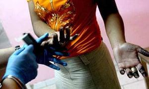 A Roma woman has her fingerprints taken near Naples
