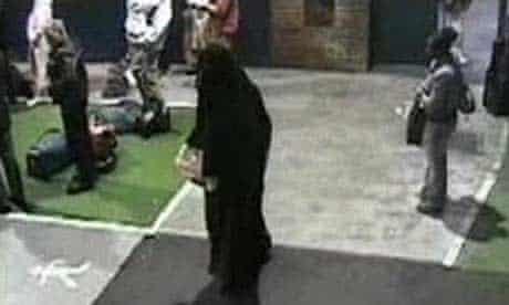 Yassin Omar dressed in a burka at a coach station in Birmingham
