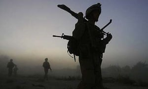 US marines, from the 24th Marine Expeditionary Unit, patrol in the town of Garmser in Helmand province, Afghanistan