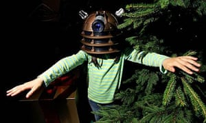 A child plays with a 'Doctor Who' Dalek Voice Changer
