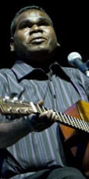 Geoffrey Gurrumul Yunupingu performs on stage
