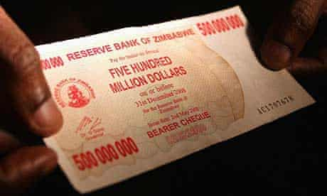 A shopper holds a Z$500m bank note in Zimbabwe