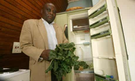 Ishmael Dube looks for something to eat in his refrigerator empty