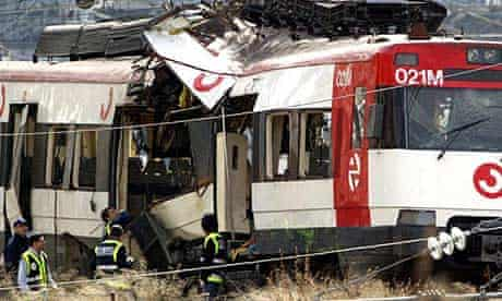 Investigators at the scene of one of the Madrid train bombings in 2004