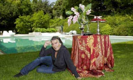 Fashion designer Roberto Cavalli by the pool of his house in Tuscany