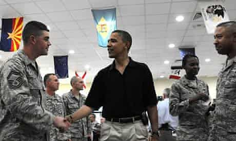 Barack Obama meets US soldiers at a military camp in Kuwait, where he stopped en route to Afghanistan