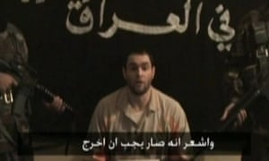 One of five British hostages in Iraq is seen in footage aired by al-Arabiya television last December