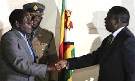 The Zimbabwe president, Robert Mugabe, left, shakes the hand of Morgan Tsvangirai, the Movement for Democratic Change leader, at the signing of a memorandum of understanding between the two parties in Harare