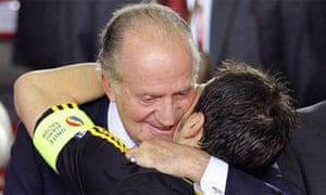 King Juan Carlos of Spain embraces footballer Iker Casillas