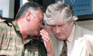 Bosnian Serb Commander Ratko Mladic speaking to Bosnian Serb leader Radovan Karadzic during a meeting in Pale, outside Sarajevo on 5 August 1993. Mdalic has been missing since 2001.